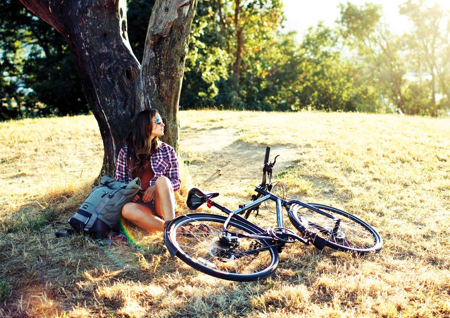 Woman-Bike-Resting-by-Tree