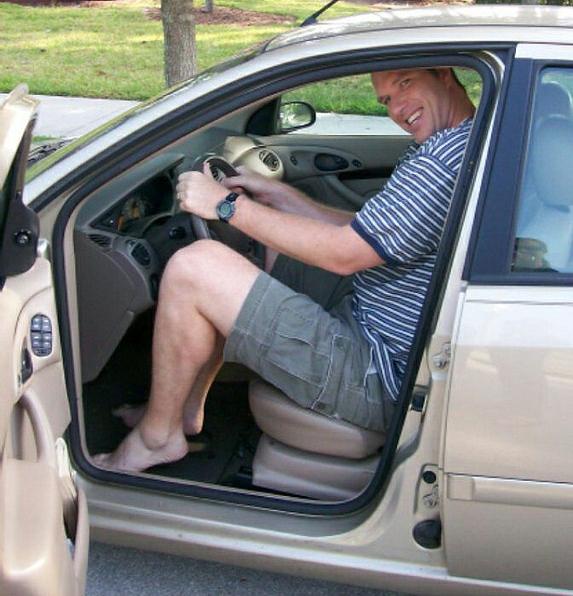 tall-man-small-car