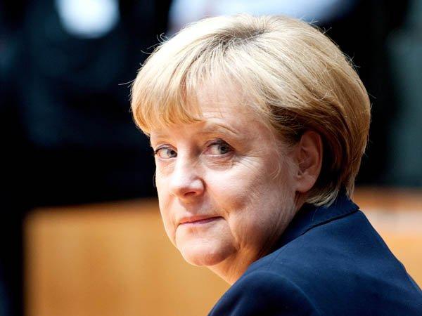 Канцер ФРГ надеется на то, что страну покинет 100 000 мигрантов
